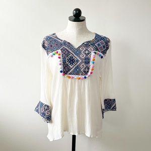 Anandas tunic shirt with pom-poms
